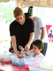 Cynthia Haddad and son Giovanni build sand art Saturday