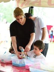 Cynthia Haddad and son Giovanni build sand art Saturday