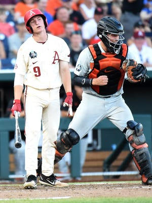 Arkansas' Jax Biggers shows his frustration after striking out against Oregon State in the finals of the College World Series last week in Omaha, Neb.