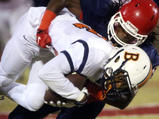 Blackman's Cedriontis Wilson (32) is brought down during Friday's loss at Oakland.