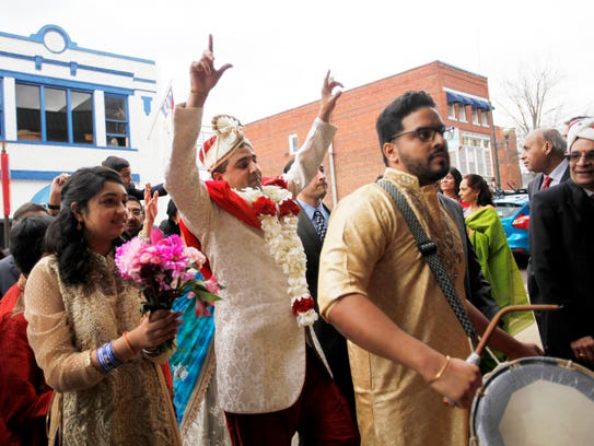Devang Desai leads wedding guests into The Venue before