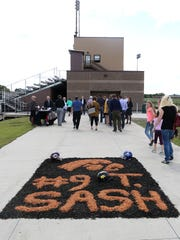 Friends, family and former teammates of former Hawkeye Tyler Sash, who attended Oskaloosa High School and also played professionally for the New York Giants, payed their respects during a memorial service at the Lacey Recreation Complex on Friday, Sept. 11, 2015, in Oskaloosa, Iowa.