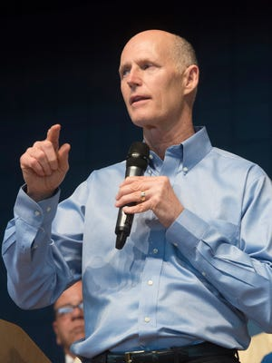 Gov. Rick Scott speaks on Thursday, May 4, 2017, to the Home Builders Association of West Florida during his stop in Pensacola.