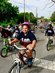 Lincoln Charter School students, faculty and families ride bikes and walk from the school to York City Hall in celebration of Bike to School Day in York City, Wednesday, May 10, 2017. Dawn J. Sagert photo