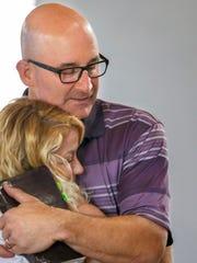 Christi Embry hugs pastor Tim Hartlage of the Southwest