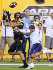 Arizona State University's Jalen Harvey (#89) catches a first down pass against University of Washington's Myles Bryant (#5) in the second quarter of their football game on Saturday, Oct. 14, 2017, at  Sun Devil Stadium in Tempe, Ariz.