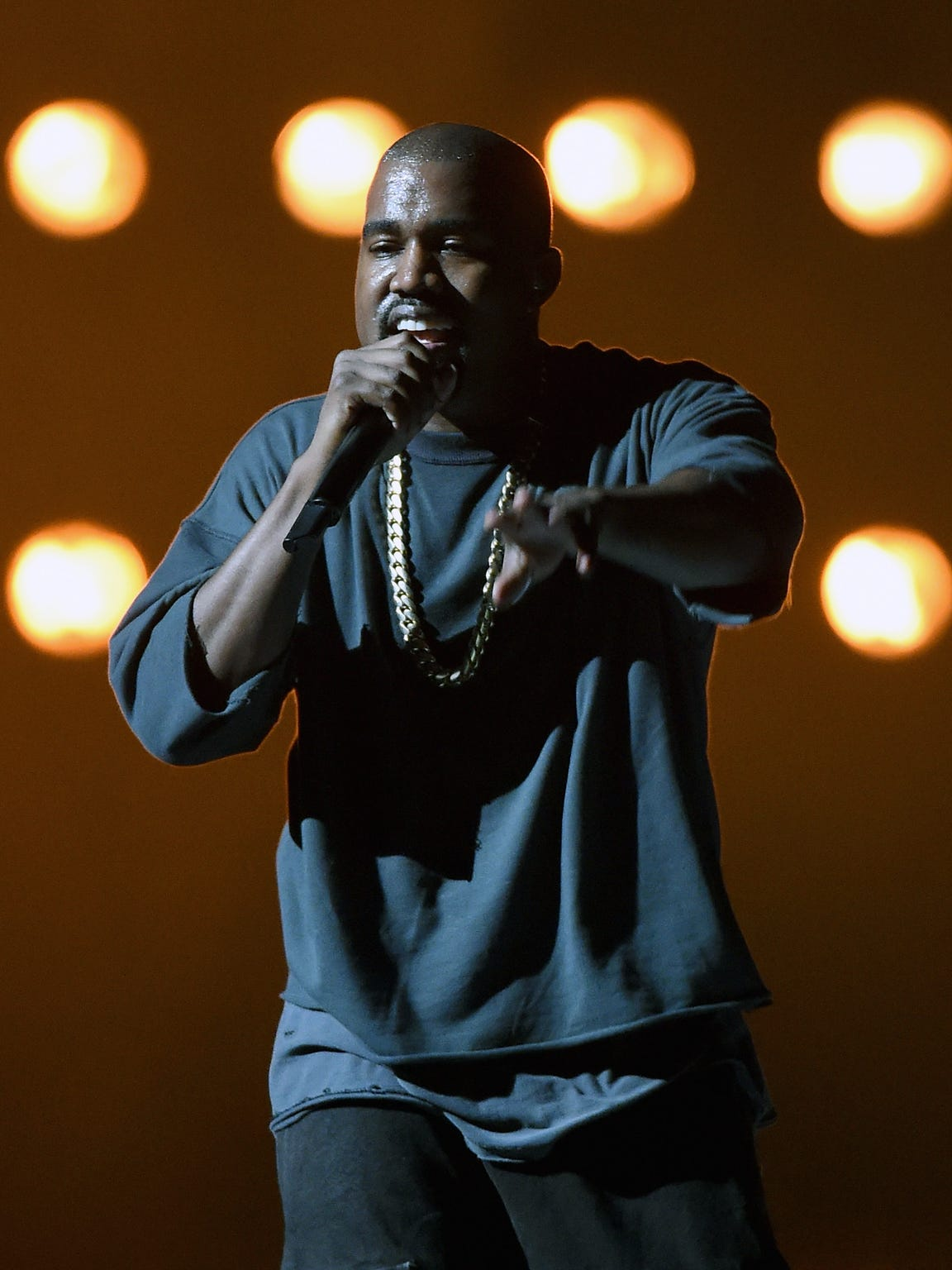 Rapper Kanye West performs at the 2015 iHeartRadio
