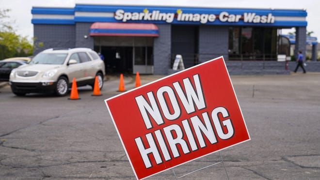 A help-wanted sign is displayed at a car wash in Indianapolis on Wednesday, Sept. 2, 2020.