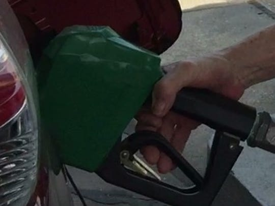 A customer pumps gasoline at the BP station on Turfway