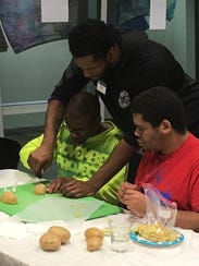 Tyler Wideman helping at Special Olympics cooking class,