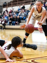 Henderson County's Jaylee Carter passes to teammate Alyssa Dickson under the Colonel basket after battling for a lose ball as the Henderson County Lady Colonels host Muhlenberg County at Colonel Gym Monday, January 30, 2016.
