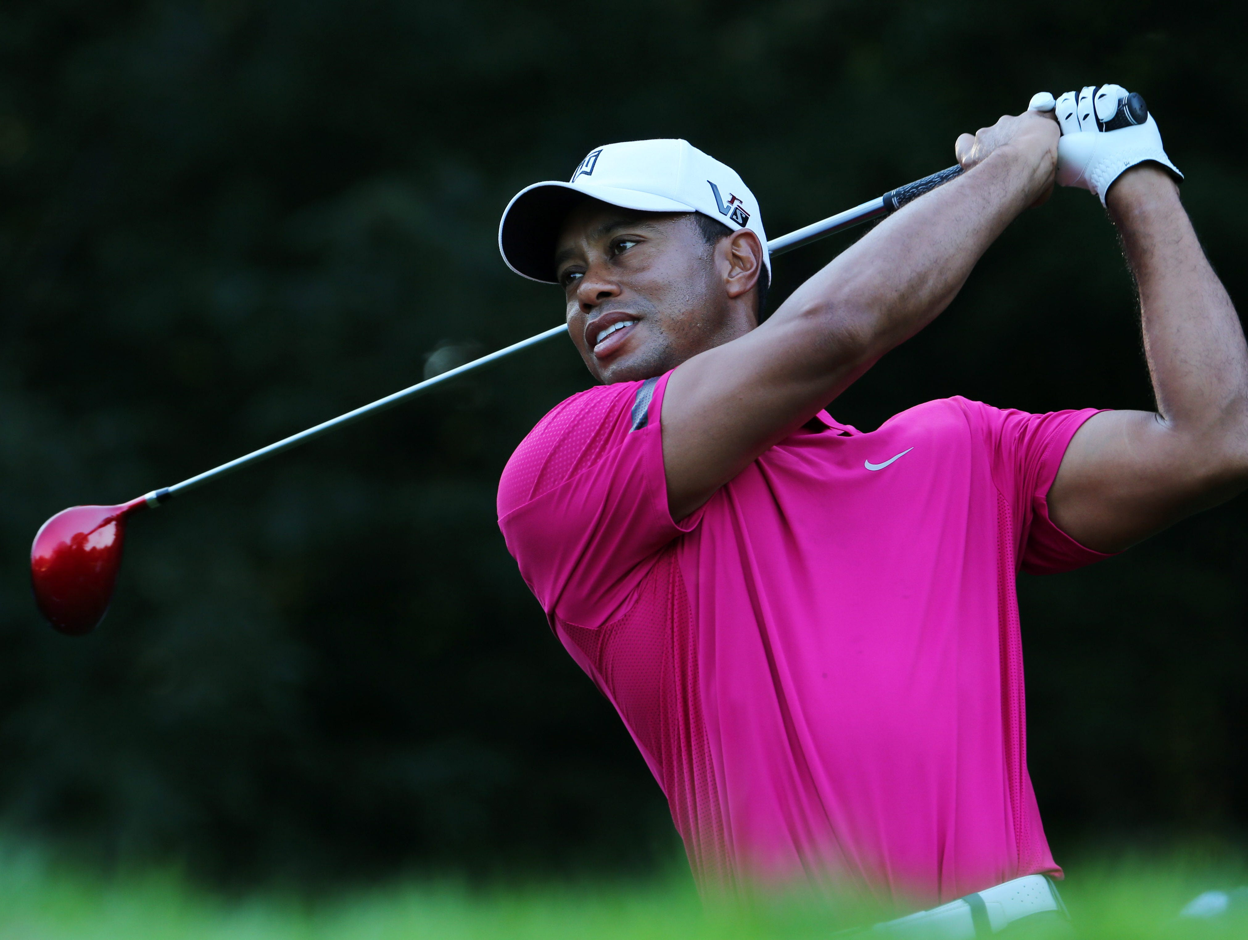 Tiger Woods tees off on the 4th hole during the practice round of the 95th PGA Championship at Oak Hill Country Club.