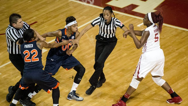 Auburn guard Hasina Muhammad (0) goes after Alabama guard Breanna Hayden (5) after Hayden hit her as the referees and Auburn guard Kiani Parker (22) attempt to hold her back Thursday at Foster Auditorium in Tuscaloosa.