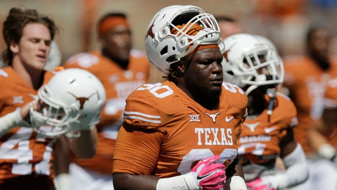 Texas' Malcom Brown (90) runs off the field prior to a game against Baylor on Oct. 4, 2014, in Austin, Texas.