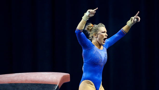 Florida Gators gymnast Bridget Sloan reacts after her vault during the team finals of the 2016 NCAA Women's Gymnastics Championships at Fort Worth Convention Center Arena.