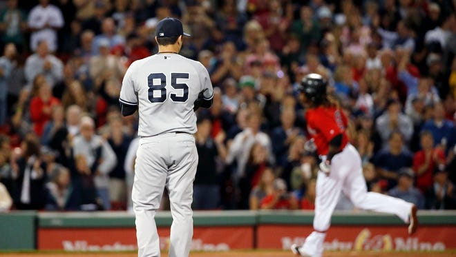 New York Yankees' Luis Cessa (85) watches as Boston Red Sox's Hanley Ramirez, right, rounds the base on his solo home run during the fourth inning of a baseball game in Boston, Friday, Sept. 16, 2016.