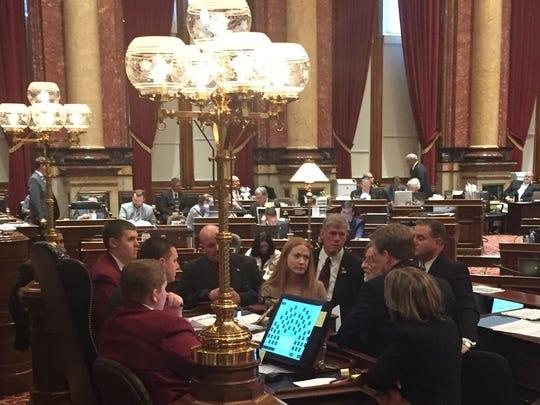 Republican and Democratic legislators huddled before Senate President Jack Whitver Thursday to discuss an amendment proposed to a  Senate education funding bill.