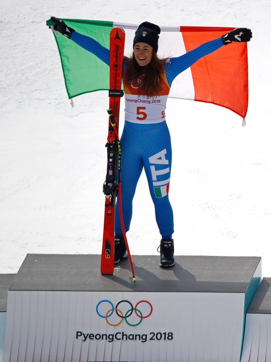 Gold medal winner Sofia Goggia, of Italy, celebrates during the venue ceremony for the women's downhill event at the 2018 Winter Olympics in Jeongseon, South Korea, Wednesday, Feb. 21, 2018. (AP Photo/Charlie )