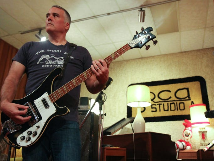 John Curley playing his Rickenbacker bass guitar at his Camp Washington recording studio Ultrasuede in October.
