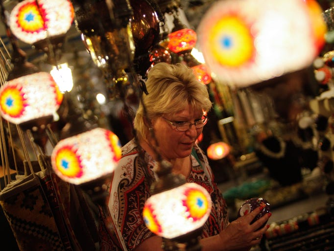 Greenville resident Sandi Waltz browses through some of the arts and crafts at the 39th Greek Festival at the Holy Trinity Greek Orthodox Church in Wilmington Tuesday.