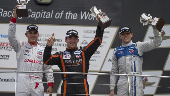 FILE -- The top three racers celebrate their victories, RC Enerson (left), Sean Rayhall, and Max Chilton, after the afternoon's Mazda Grand Prix of Indianapolis, Indy Lights Series, Indianapolis, Saturday, May 9, 2015.