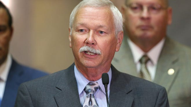City-County Councilman Jack Sandlin, a former Indianapolis Metropolitan Police Department officer, spoke at a news conference Tuesday, Aug. 2, 2016, at the Indiana Statehouse about planned legislation to protect public safety officials.