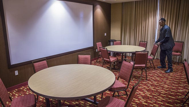 Alvin Loper arranges a banquet room for an upcoming event at the Courtyard Marriott in this file photo.