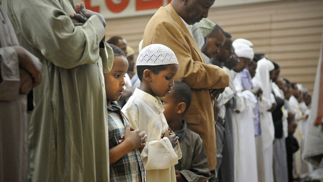 St. Cloud area Muslims gather in worship in Aug., 2011, to mark the end of Ramadan in the St. Cloud Tech High School gymnasium.
