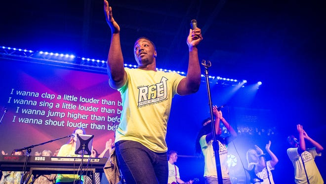 Georedt Huggins and the ChristFest Community Choir perform during Fields of Faith at the Muncie Fieldhouse Wednesday night.