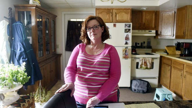 Amy Edwards stands for a portrait in her Red Lion apartment Wednesday, May 24, 2017. Edwards' estranged husband Matthew Biondo has pleaded guilty or been found guilty of violating protection-from-abuse orders 14 times since 2007. Their case is an example of the limitations of protective orders.