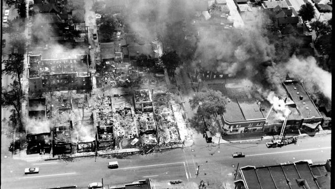 12th Street is pictured under a cloud of smoke during the rioting in 1967. Errant flames of the 1967 riot swept into residential sections destroying solid homes of longtime residents.