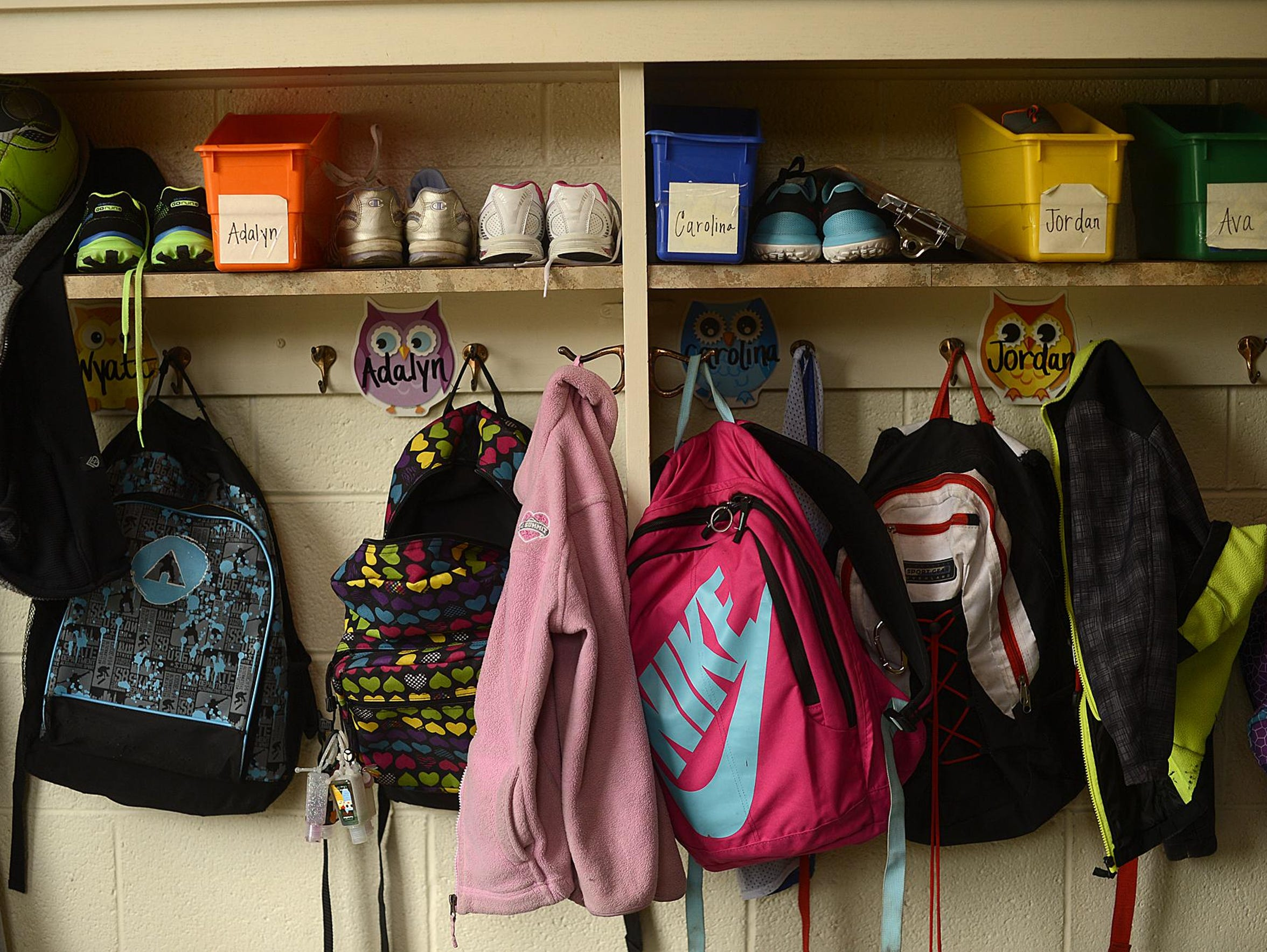 Backpacks hang on racks at St. Matthews and Resurrection