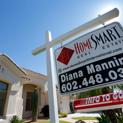 Consumer confidence in metro Phoenix's housing market dropped over the summer as sales and price increases sagged. Here is a house for sale on Wednesday, Sept. 3, 2014, in the Ahwatukee area of Phoenix.