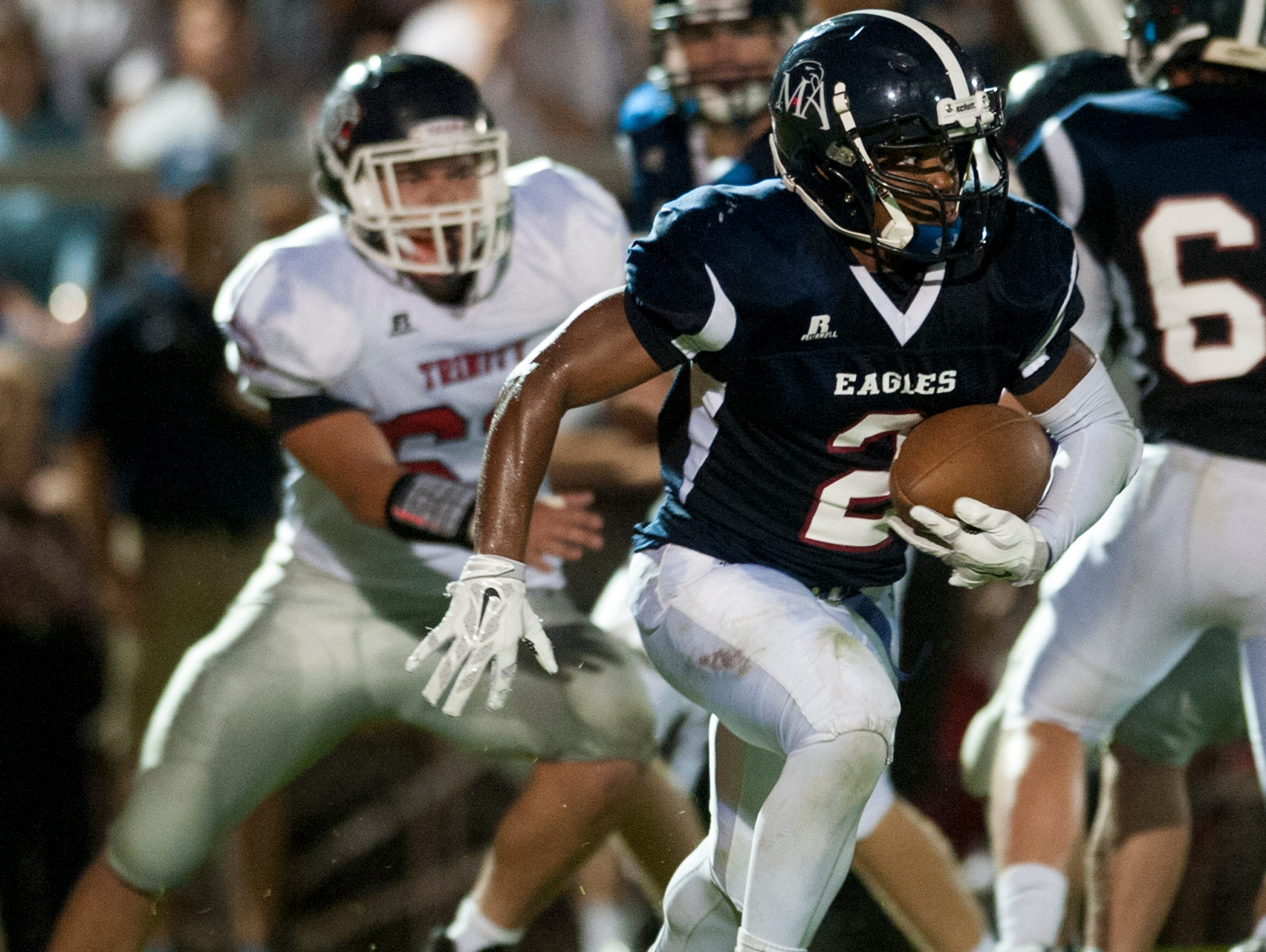 Montgomery Academy's Nelson Whyte (2) carries against Trinity at the Montgomery Academy campus in Montgomery Al. on Friday September 25, 2015.