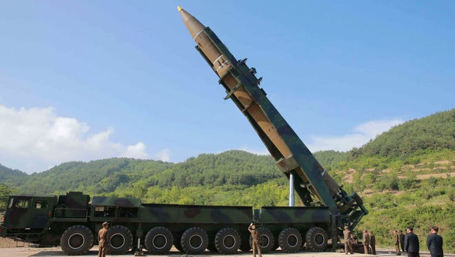 In this July 4, 2017, file photo distributed by the North Korean government, North Korean leader Kim Jong Un, second from right, inspects the preparation of the launch of a Hwasong-14 intercontinental ballistic missile (ICBM) in North Korea's northwest. For nearly 70 years, the three generations of the Kim family have run North Korea with an absolute rule that tolerates no dissent. The ruling family has devoted much of the country's scarce resources to its military but has constantly feared Washington is intent on destroying the authoritarian government.