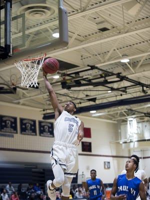Randy Bell of Timber Creek goes up for two of his 20 points in Saturday's win over Paul VI.