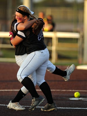 Wylie's Kamwren Jackson (10) celebrates with teammate Bailey Buck (17) after the Lady Bulldogs' 1-0 win over Brownwood in the District 5-4A tiebreaker on Friday, April 21, 2017, at Poly Wells Field.