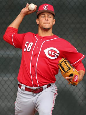 Cincinnati Reds starting pitcher Luis Castillo (58) throws during a bullpen session, Thursday, Feb. 15, 2018, at the Cincinnati Reds Spring Training facility in Goodyear, Arizona.