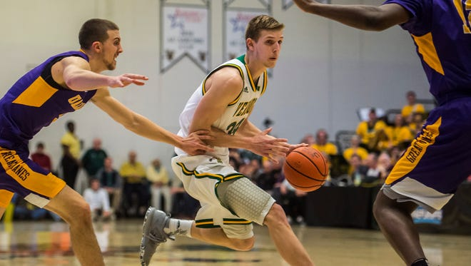 UVM's  #34 Kurt Steidl tries to get away from Albany's #3 Joe Cremo to move to ball up court during the America East Championship at Patrick Gym in Burlington, Vt., on Saturday, March 11, 2017. UVM won, clinching their place in the NCAA tournament, 56-53.
