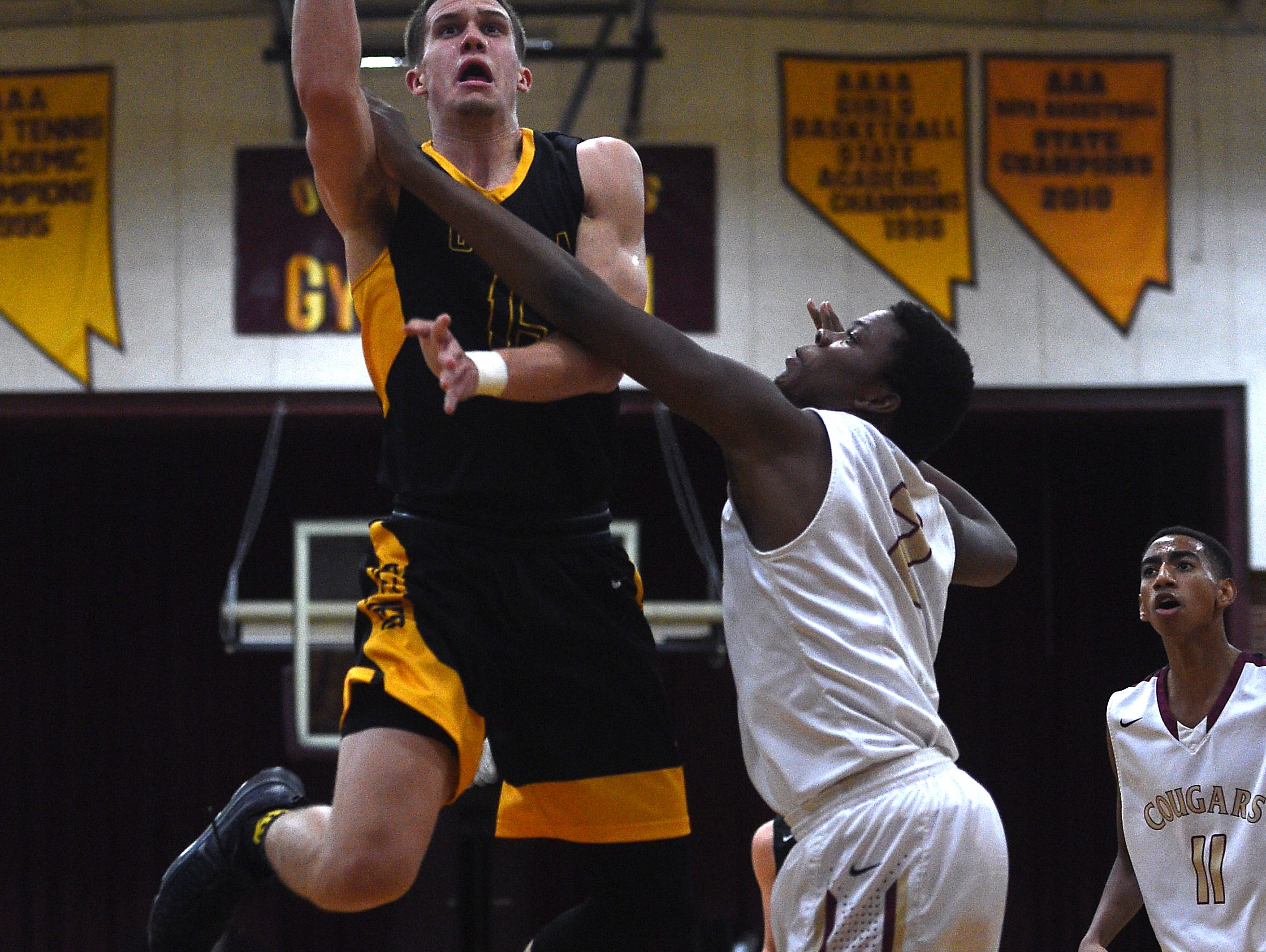Galena's Dillon Voyles (15) shoots over Golden Valley's Etrell Bowers (2) during the Railroader Classic basketball tournament at Sparks High School on Dec. 2, 2016.