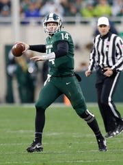 Michigan State quarterback Brian Lewerke looks downfield