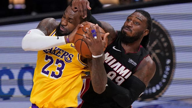 Los Angeles Lakers forward LeBron James and Miami Heat forward Jae Crowder battle for a rebound  Tuesday in Lake Buena Vista, Fla.
