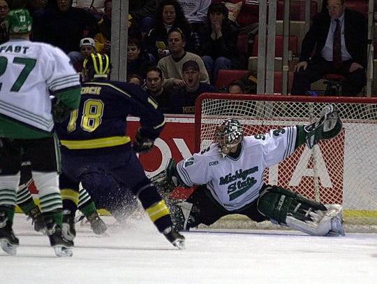 Michigan State's Ryan Miller makes a save in first-period