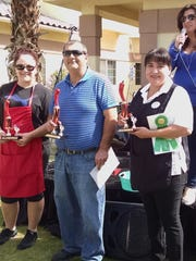 Winners in the chili cook-off were Wendy Napolitan, third place (left); Sam Edalati in first place; Angelica Urias with second place; and host Mandy Calvano in the background.