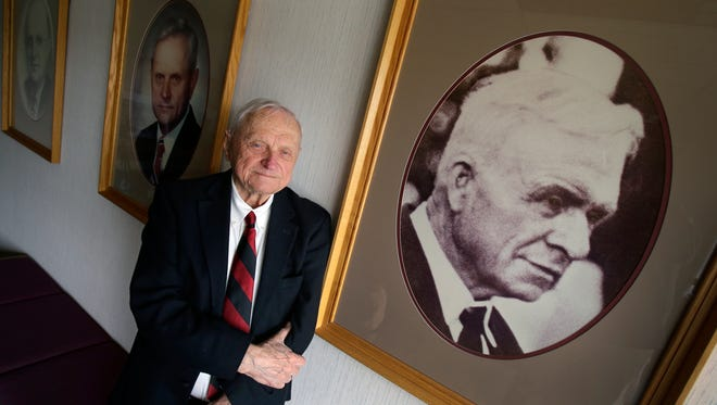 Oscar C. Boldt, Chairman of The Boldt Company, says that is grandfather Martin Boldt, in portrait at right, was his greatest influence. Behind Oscar is a portrait of his father Oscar J. Boldt, far left, and a portrait of himself on April 16, 2014 in Appleton, Wisconsin. Dan Powers/Post-Crescent Media