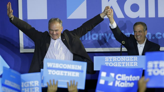 Virginia Sen. Tim Kaine, left, is introduced Tuesday to the crowd by Democratic Senate candidate Russ Feingold during a campaign visit in Lawrence University's  Warch Campus Center in Appleton.