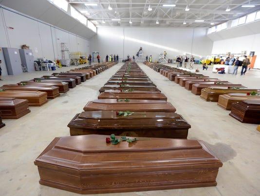 migrant coffins