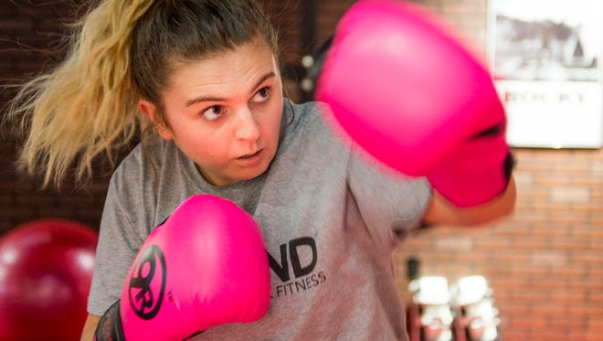 Samantha Malburg of Auburn Hills works out at 9Round kickboxing gym in Troy.