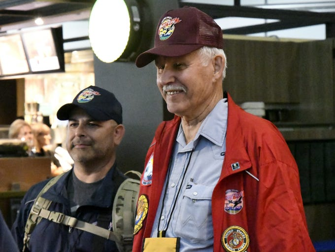 Veteran Gordon Bell, 81 of Visalia, waits to board