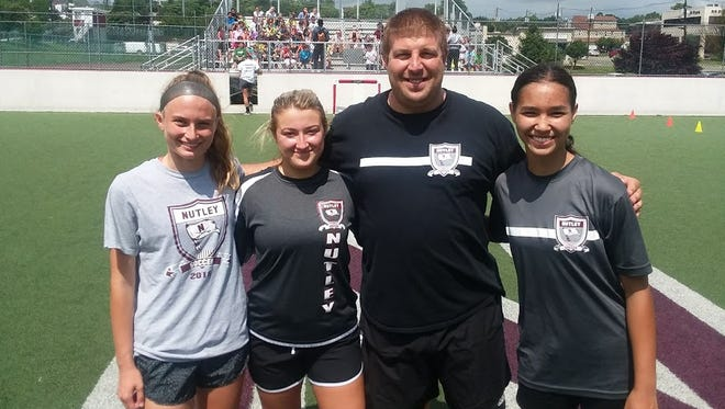 Nutley girls soccer 2018 captains (from left) Emily DeAngelo, Giulia Polewka and Danielle Lohf along with coach Mike DiPiano.